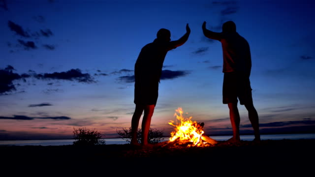 WS Men Giving High Five By The Bonfire video