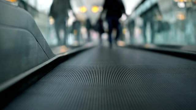 Men go on Moving walkway video