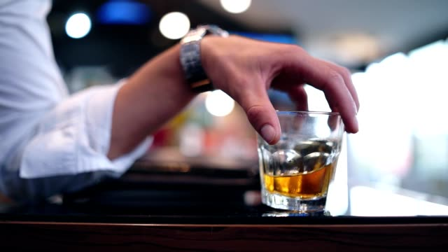 men holding glass of whiskey - scotch whisky video stock e b–roll