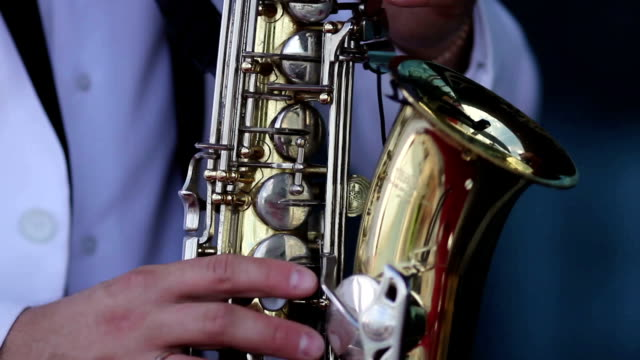 men in a white jacket  playing the saxophone video