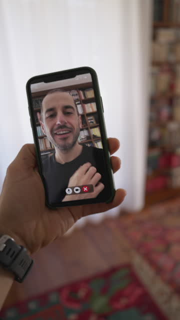 Men in video call from mobile phone camera video