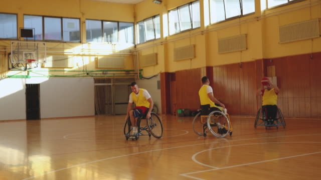 Men in wheelchair playing para basketball