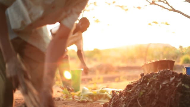 Men on rural African farm working video