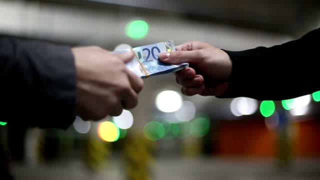 Men pass money euro banknotes. Slow motion. video