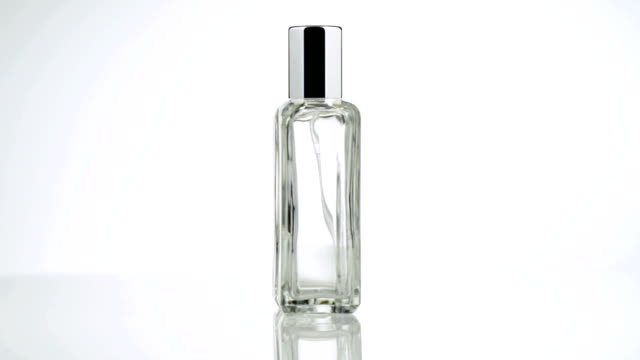 Men perfume. Bottle spray in rotation video