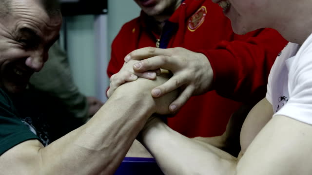 Men practicing arm wrestling in the gym video