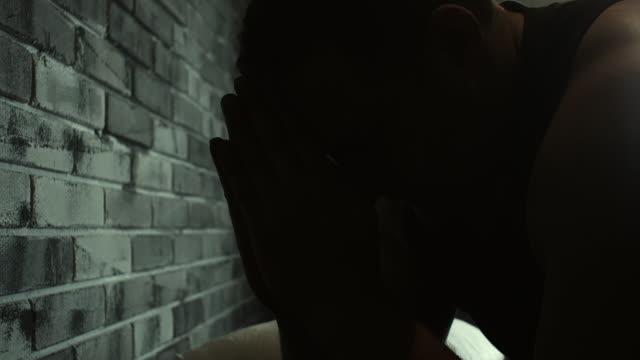 Men praying at prison cell video