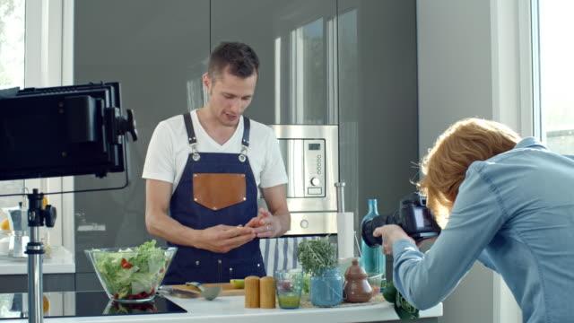 Men Recording Cooking Show video