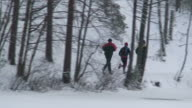 istock Men relay in winter (HD 1080/50i) 472412759