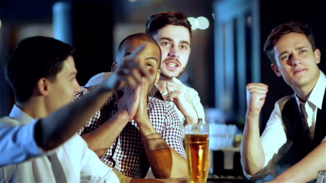Men shout and rejoice in meeting and drink beer video