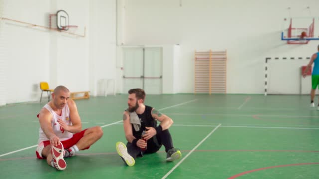 Men Taking A Rest After Playing Basketball video