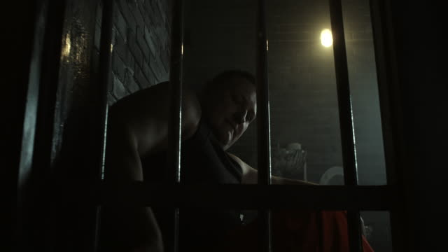 Men taking food from prison floor and eating Men taking food from prison floor and eating sentencing stock videos & royalty-free footage