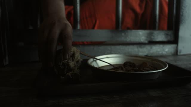 Men taking food from prison floor Men taking food from prison floor sentencing stock videos & royalty-free footage