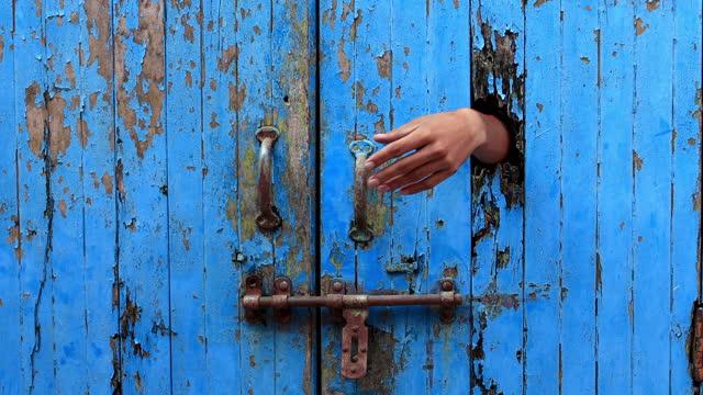 Men trying to open wooden door video