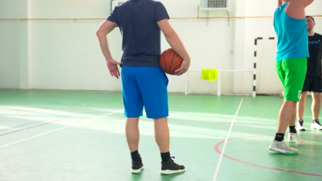 Men Warming Up Before Playing Basketball video