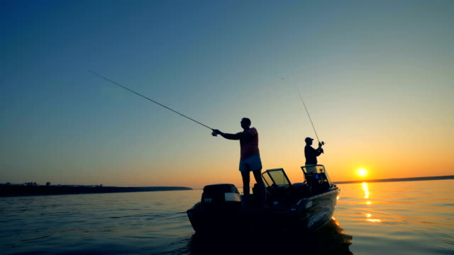 men with a boat on a fishing trip, close up. - spranga video stock e b–roll