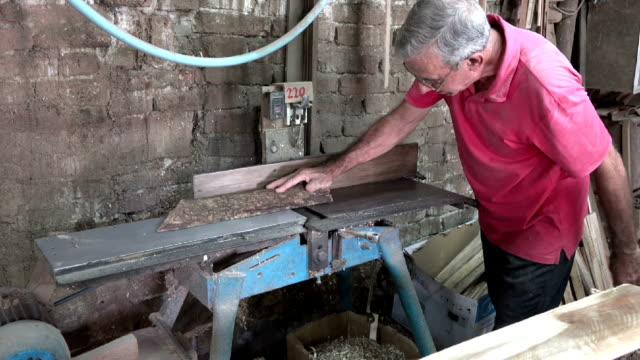 Men working in Cuban carpentry shop video