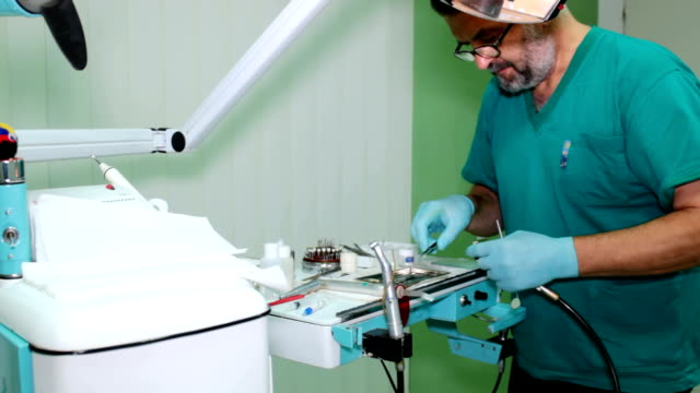 Mending patient's teeth video