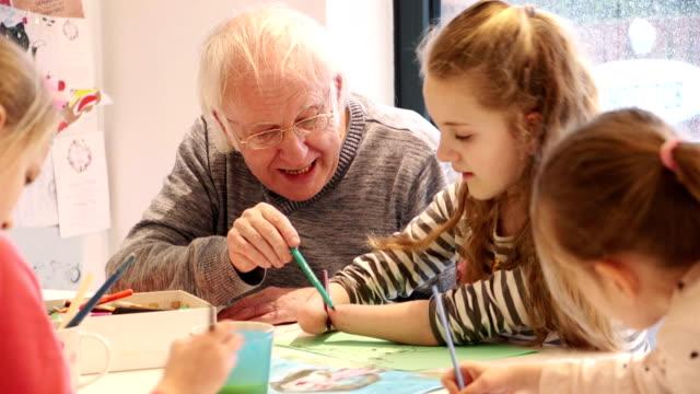 Meningitis Survivor Painting on the Dining Room Table with Grandpa! video