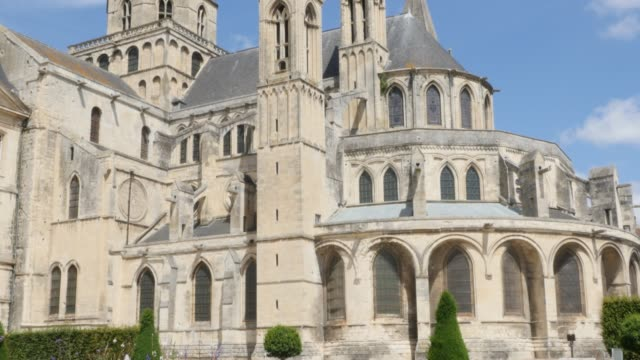 Mens Abbey exterior located in Normandy France by the day 4K Mens Abbey exterior located in Normandy France by the day 4K 3840X2160 slow tilt UltraHD footage - Famous French Abbaye aux Hommes located in city of Caen   Normandie  4K 2160p UHD footage caen stock videos & royalty-free footage