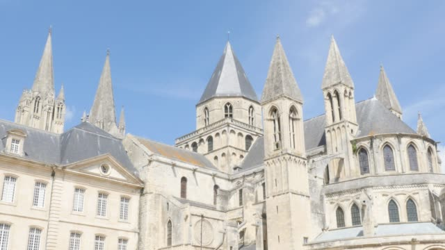 Mens abbey religious place in Normandy France by the day 4K Mens abbey religious place in Normandy France by the day 4K 3840X2160 slow tilt UltraHD footage - Famous French Abbaye aux Hommes located in city of Caen Normandie  4K 2160p UHD video caen stock videos & royalty-free footage