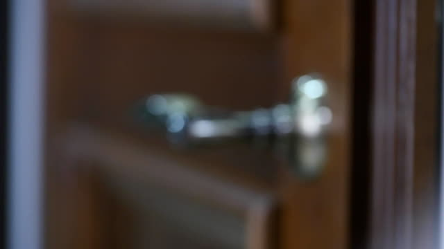 Men's hand opens and closes the door. selective focus video