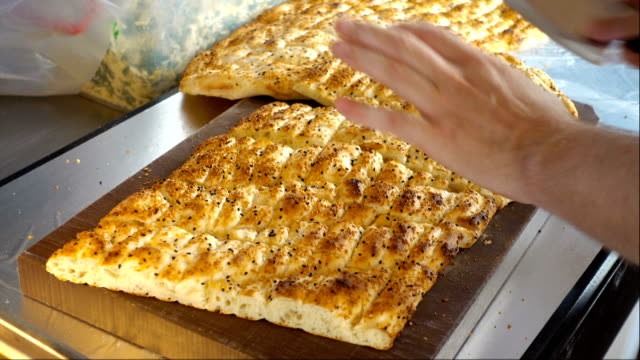 mens hands cut the pie with sesame in kitchen video