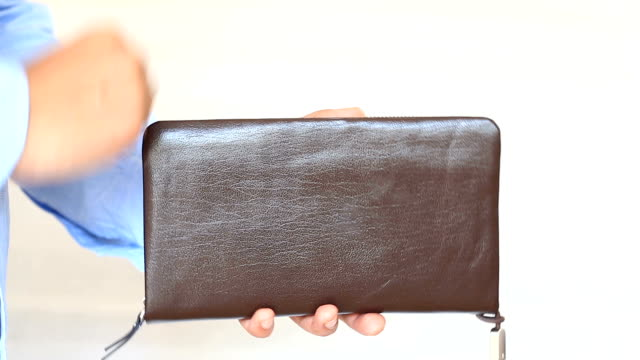 Men's hands hold a purse with dollars video