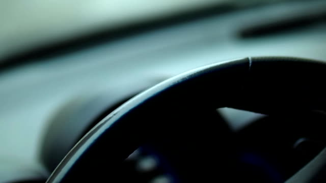 Men's hands nervously hit the steering wheel of the car in a traffic jam. Close-up video