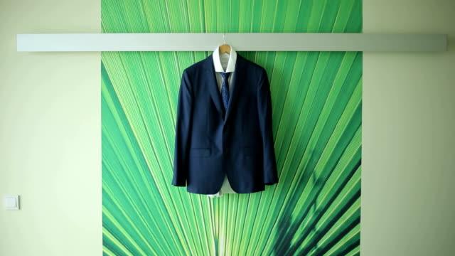 men's suit hanging on the hanger men's suit hanging on the hanger coathanger stock videos & royalty-free footage