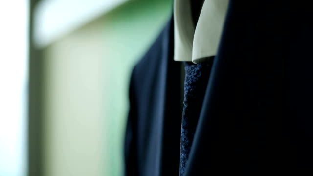 men's suit hanging on the hanger video