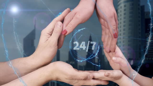Men's, women's and children's hands show a hologram 24 7
