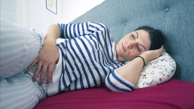 vídeos de stock e filmes b-roll de menstruation problems. - doença