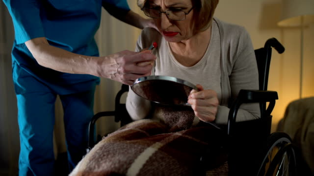 Mental disorder woman applying lipstick and nurse taking makeup away, lost time video