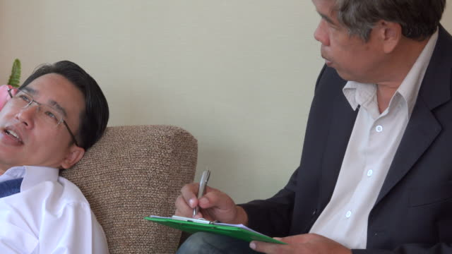 Mental Health Professional Takes Notes As Patient Talks About video