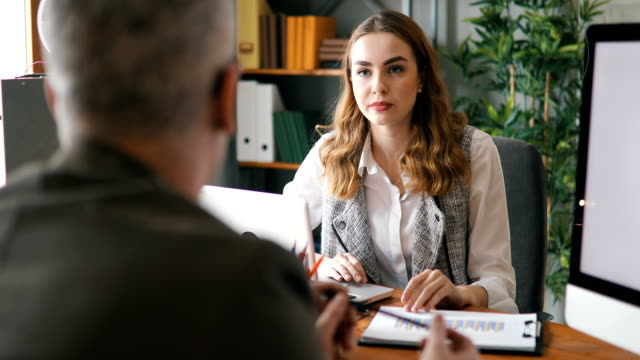 Mentoring Manager is having a meeting with his worker job interview stock videos & royalty-free footage