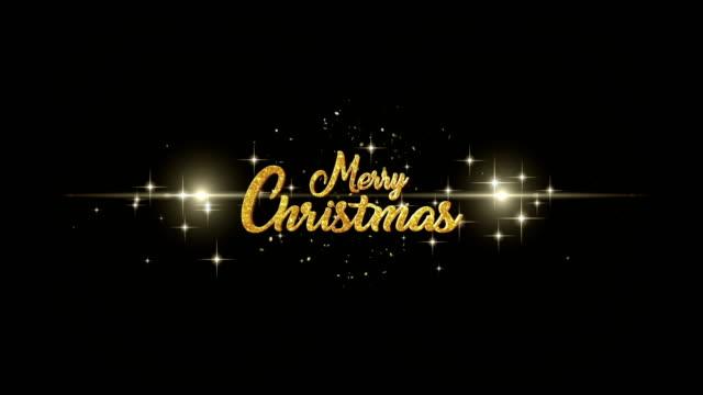god jul hälsning text gjord av tomtebloss ljus mörka natthimlen med colorfull fyrverkeri. - text bildbanksvideor och videomaterial från bakom kulisserna