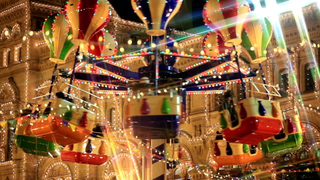 Merry Go Round in festive lights on the Christmas carnival. video