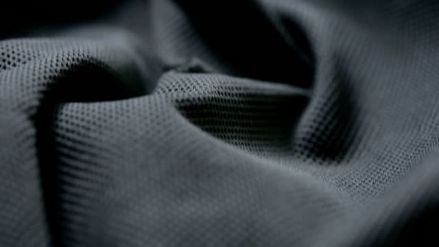 mesh cloth. black synthetic fabric. can be used as a background video