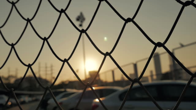 Mesh fence and sun sky,Slow motion
