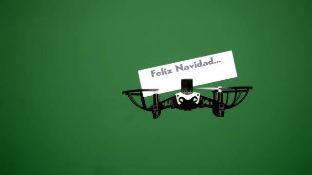 Message delivery by drone : season's greetings on a green screen, spanish version video