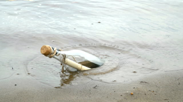 Message in a bottle on the seashore