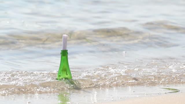 послание в бутылке - кораблекрушение стоковые видео и кадры b-roll