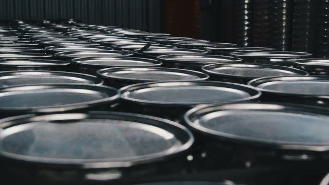 metal barrels. - brent video stock e b–roll