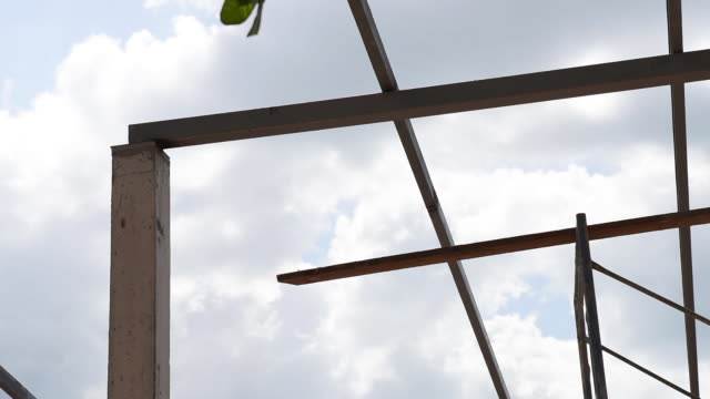 Metal beam steel roof structure at house construction site, dolly shot