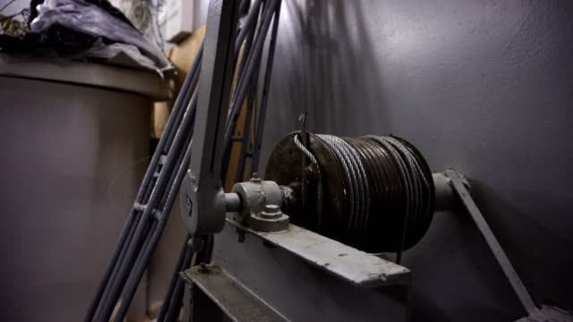 Metal cable reel unwrapping, close-up view video