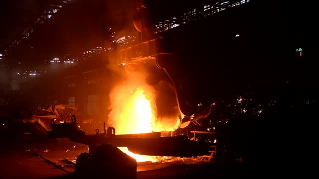 Metal casting process in metallurgical plant. Liquid metal pouring into molds Metal casting process in metallurgical plant. Liquid metal pouring into molds. foundry stock videos & royalty-free footage
