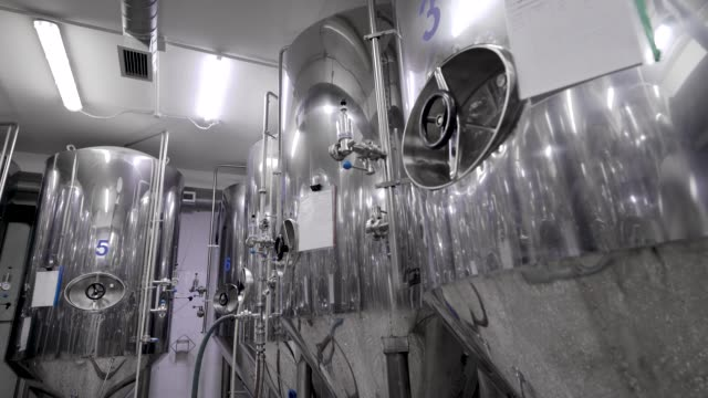 metal cisterns for mashing malt for beer are standing in shop of industrial brewery, round panoramic view metal cisterns for mashing malt for beer are standing in shop of industrial brewery, round panoramic view, modern brewery storage tank stock videos & royalty-free footage