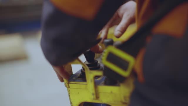vídeos de stock e filmes b-roll de metal factory operator operating remote, close up - man joystick