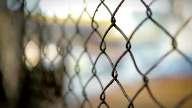 Metal fence in south american latin city. Pull focus on protective security fence video